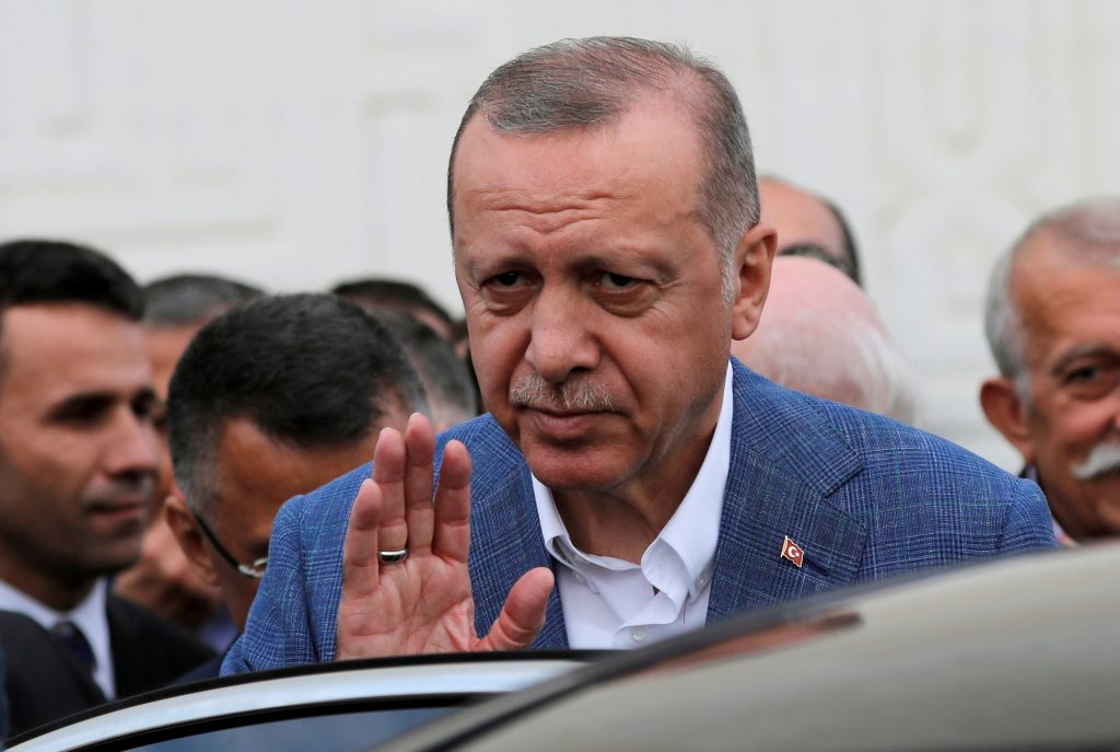 FILE PHOTO: Turkish President Tayyip Erdogan leaves a mosque after attending the Eid al-Fitr prayers to mark the end of the holy month of Ramadan in Istanbul, Turkey, June 4, 2019. REUTERS/Murad Sezer/File Photo