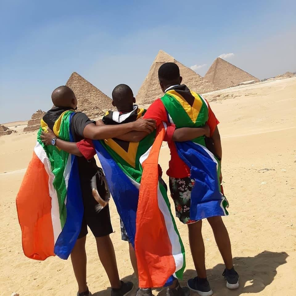 African fans look to the pyramids giving their back to the camera