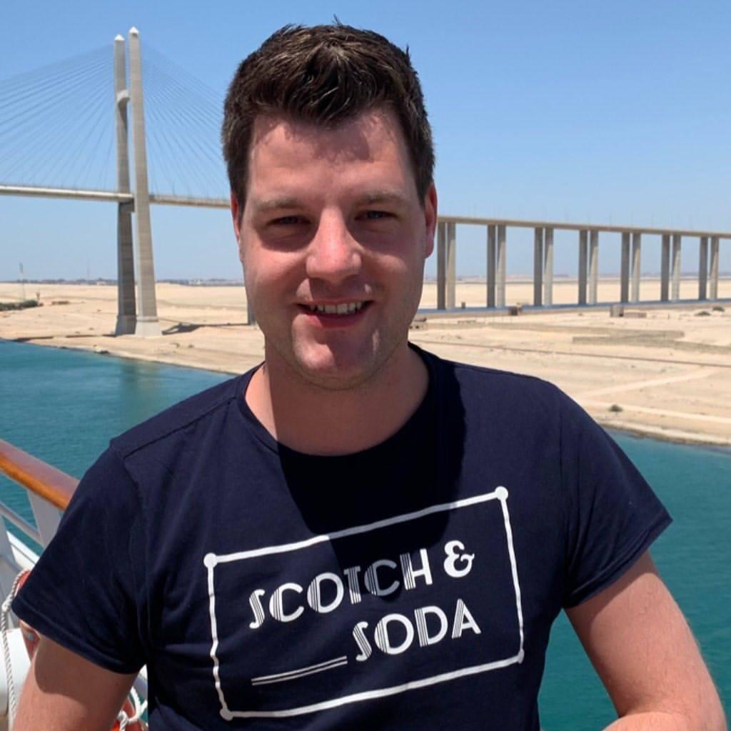 A man show his happiness in Suez Canal with its Bridge