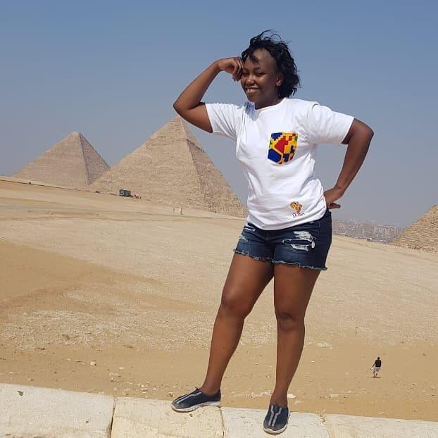 A girl takes funny photo with the pyramids