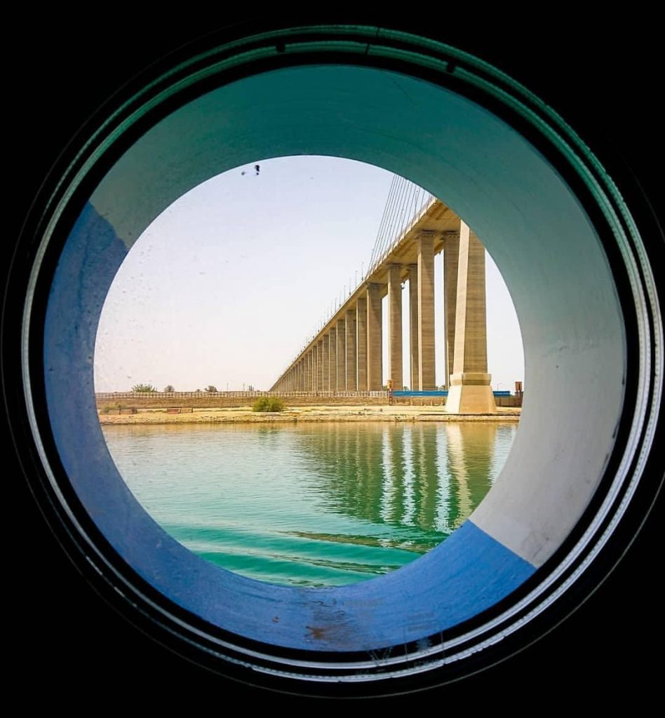 A window in a ship shows the bridge