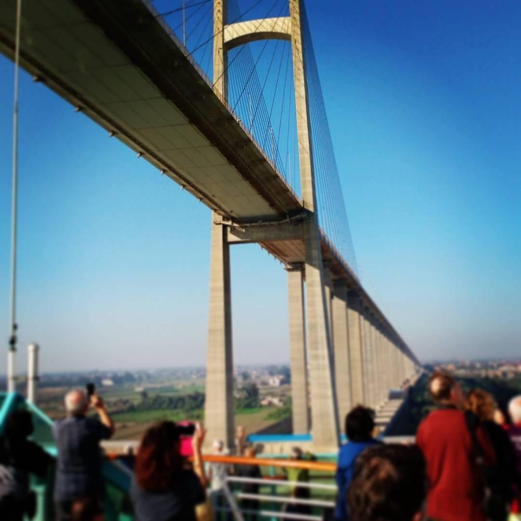 People under Suez Canal bridge take photos