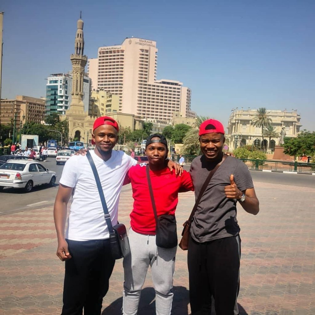 Three fans takes photo in Egypt