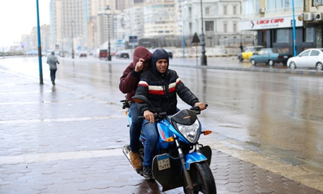 Two Egyptian Men Try To Avoid Rains